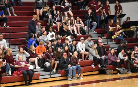 Edmond Memorial crowd watching a boys basketball game with an apparent lack of interest.