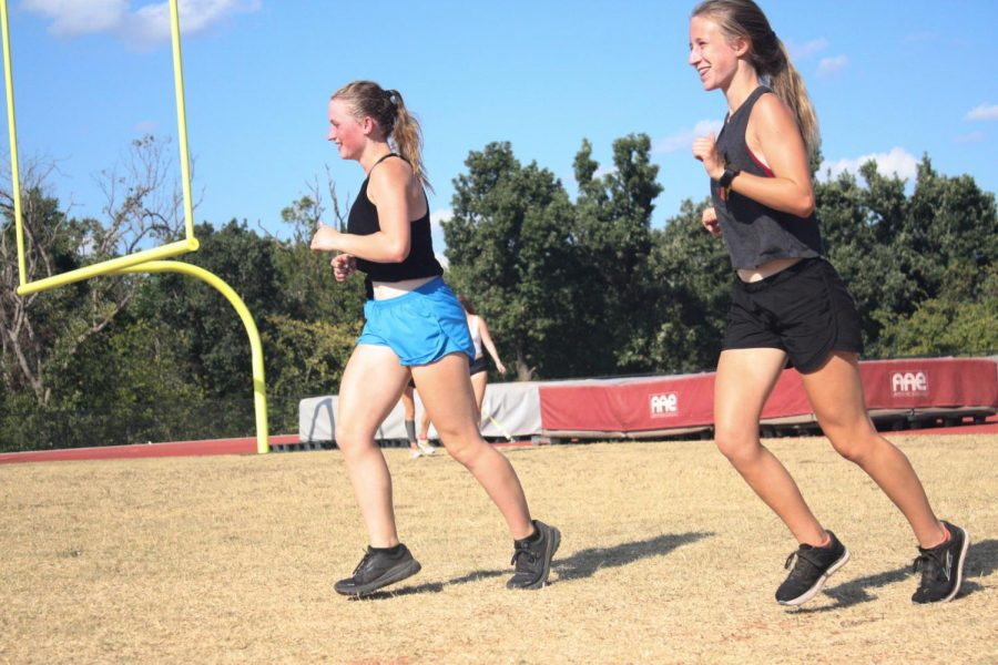 Cross+country+runners+practice+and+tune+their+skills+at+paced+practices+after+school.