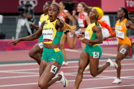 Elaine Thompson-Herah after winning one of her three medals in Tokyo.
